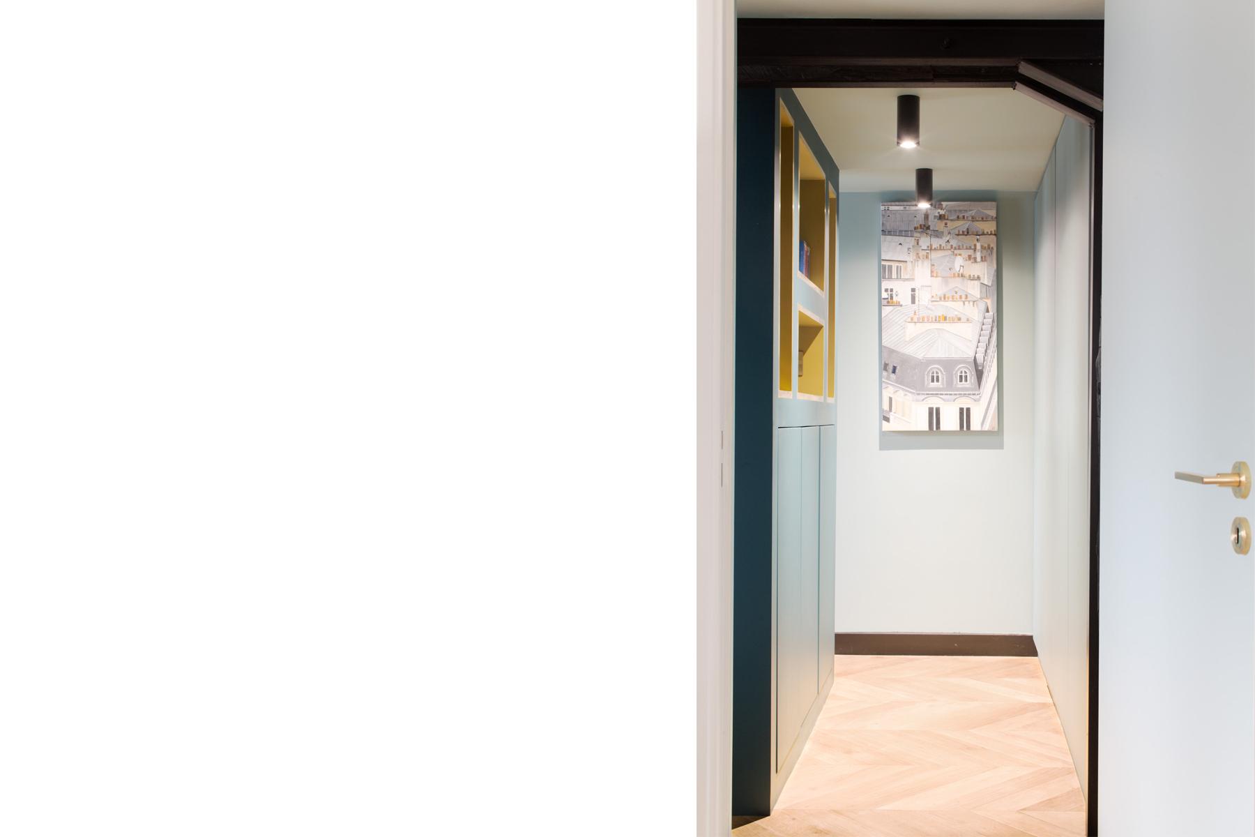ban architecture renovation appartement paris interieur haussmannien combles comble or laiton grands boulevards 122